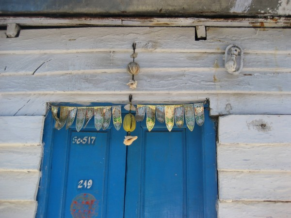 shells hung above a doorway in Coonoor.