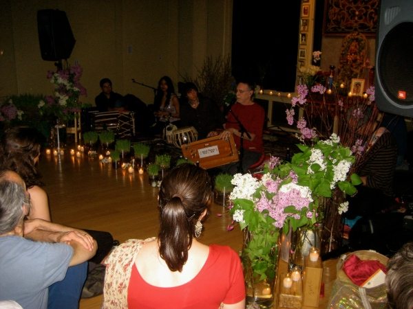 Krishna Das in front of the Jivamukti altar