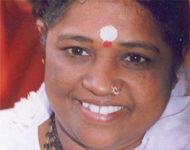 beautiful, smiling, loving Amma, open to the world.