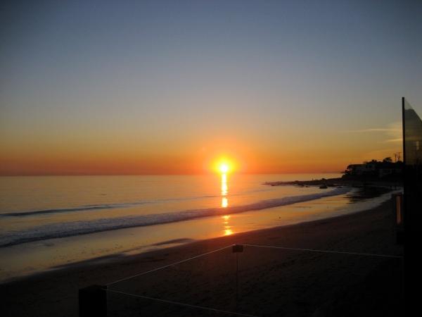 sun setting in malibu.